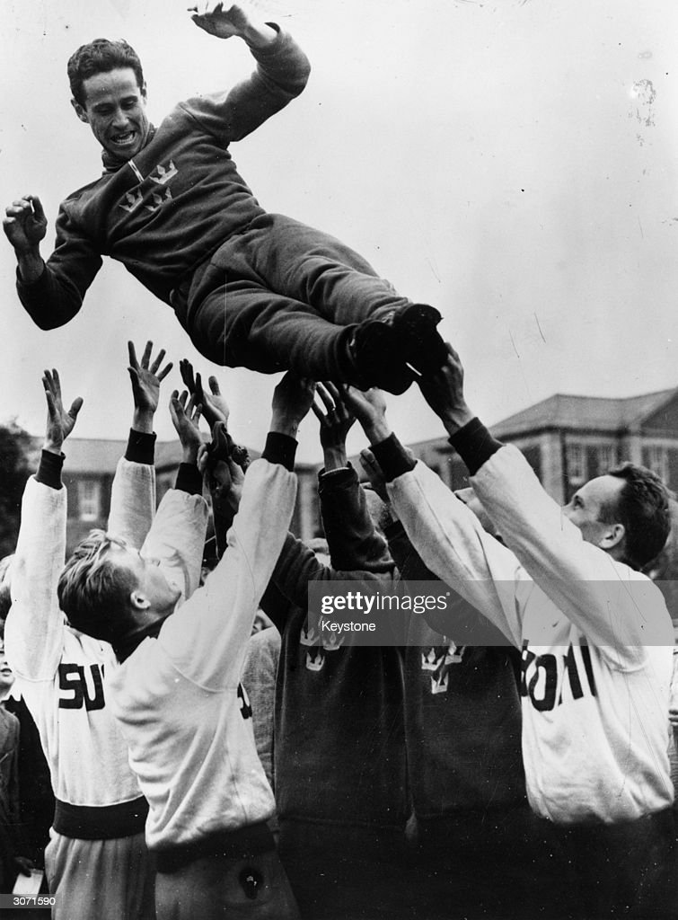 Members of the team toss the winner of the pentathlon, Captain Willian Grut of Sweden into the air. By winning three of the events outright (riding, fencing and swimming) he established a world record,being the first competitor ever to do this.