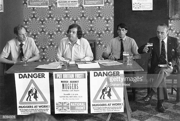 Members of the National Front including Martin Webb 2nd left meet the press at the Ravensbourne Public House Catford