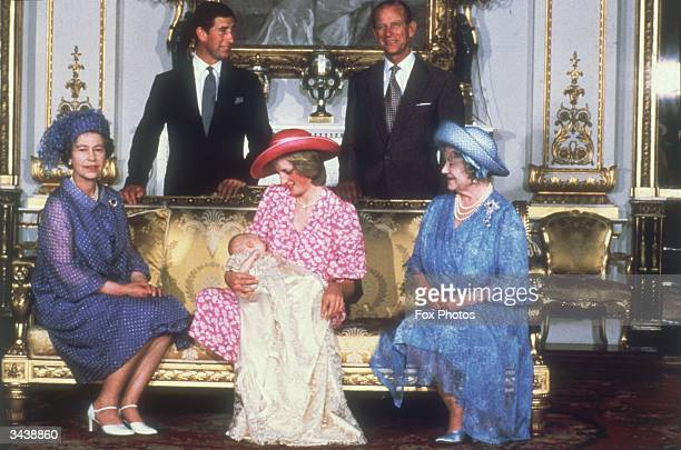 Diana Princess of Wales holding her son Prince William with Charles Prince of Wales Prince Philip the Duke of Edinburgh Queen Elizabeth II and Queen...