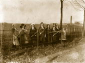 Girls' Beating the Bounds' at a fence near St Albans in Hertfordshire