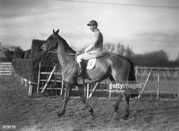 Jockey and later thriller writer Dick Francis on Mrs CA HallHall's Grand National entry Fighting Line the