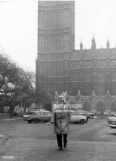 Harold Wilson outside the Houses of Parliament London in the year he succeeded Hugh Gaitskell as leader of the Labour party He is wearing a Gannex...