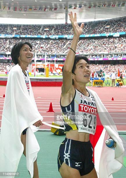 4th finish Naoko Sakamoto and silver medalist Mizuki Noguchi acknowledge to the crowd after the Women's Marathon during the 9th IAAF World Athletics...