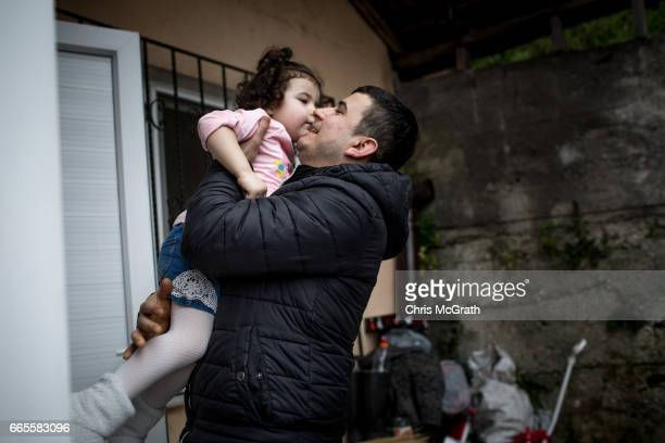 4th generation coal miner Sezai Aydin plays picks up his daughter Berra after arriving home from working his shift at a small coal mine on April 5...