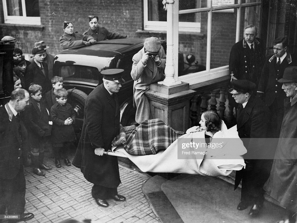 English socialite Unity Valkyrie Mitford daughter of the 2nd Baron Redesdale being carried on a stretcher from a hotel at Folkestone to a waiting...