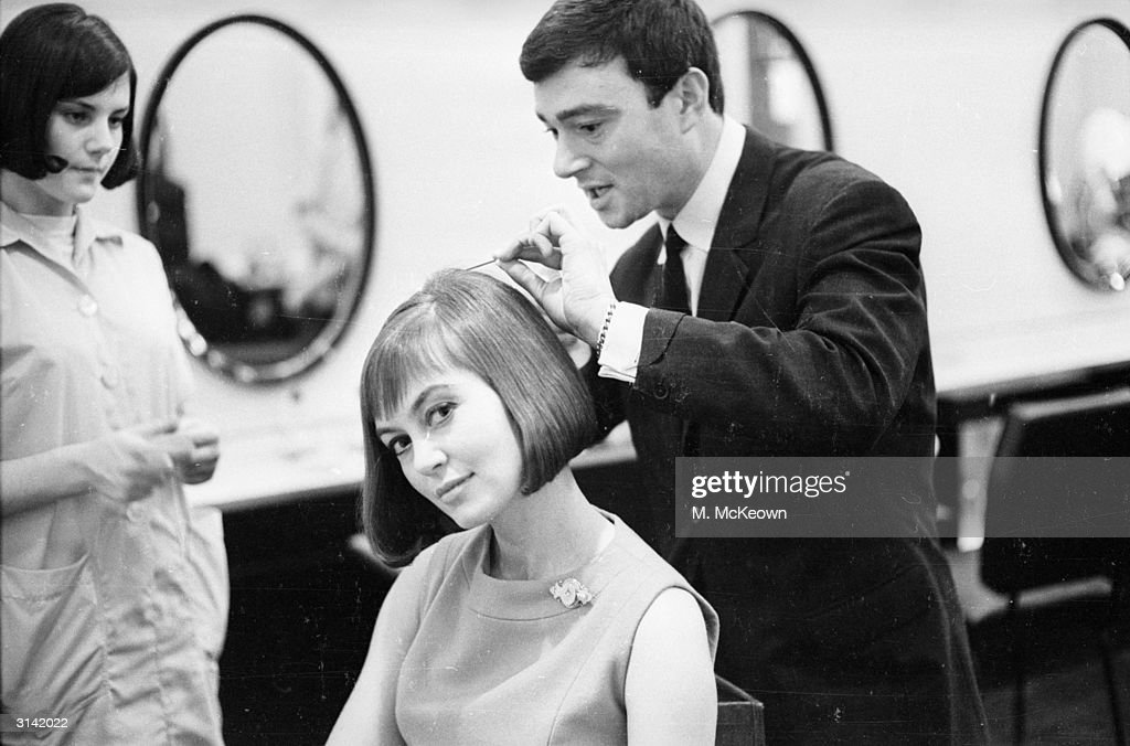 British hairdresser Vidal Sassoon creates a long bob with a soft fringe for actress Janette Scott.
