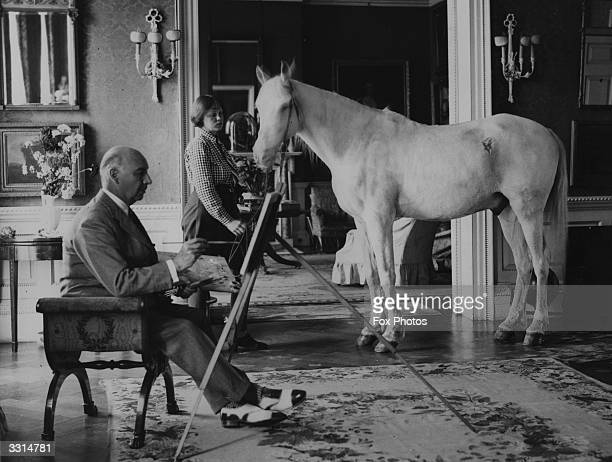 Lord Berners painting a picture of Mrs P Betjeman and her pony in the drawing room of his Berkshire home