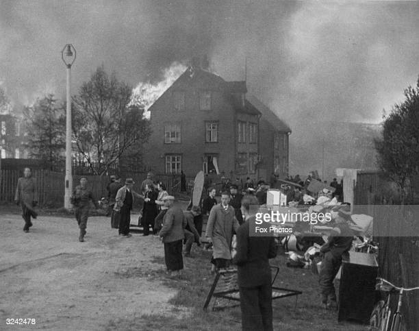 Houses are burnt to the ground in the Norwegian city of Narvik during the German invasion