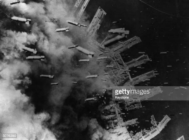 3000 tons of incendiary bombs drop on Japanese positions in the dock area of Kobe Railway shops and a heavy industrial area were totally destroyed
