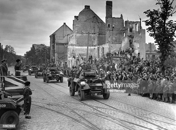 Major General Lyne Commander of the British Troops in Berlin takes the salute in a drivepast of the Desert Rats British troops who had fought at El...