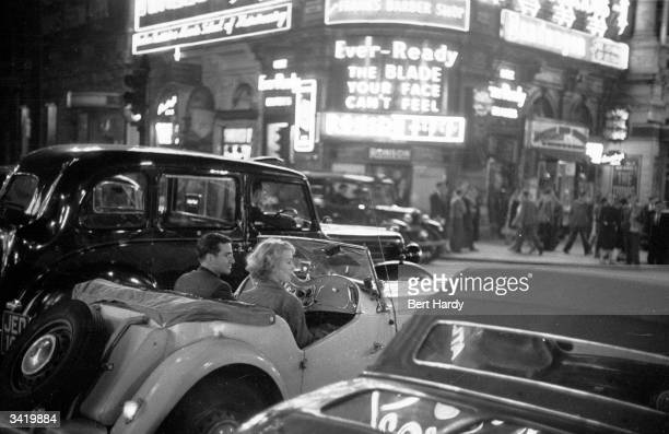 People driving through the busy streets of the Piccadilly district of London Original Publication Picture Post 6576 Known Your Piccadilly pub 1953