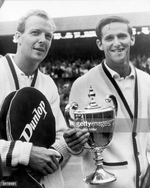 Australian tennis player Roy Emerson with his opponent Fred Stoles and the Men's Singles Trophy which he won at the Wimbledon Lawn Tennis...