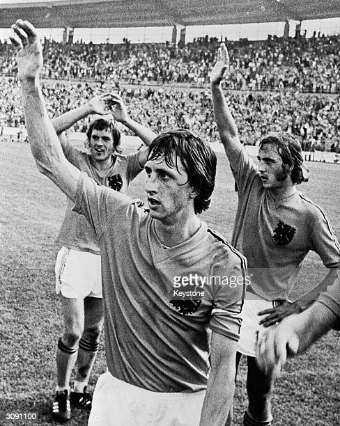 From left to right Dutch footballers Johnny Rep Johan Cruyff and Johan Neeskens waving to the crowds before the World Cup Final against West Germany