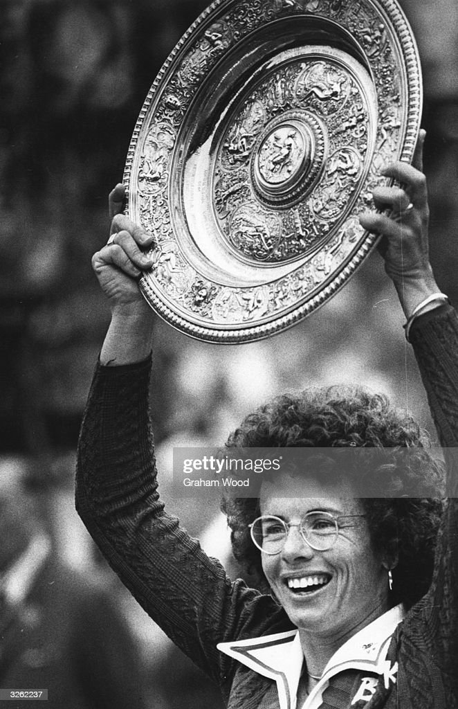 <a gi-track='captionPersonalityLinkClicked' href=/galleries/search?phrase=Billie+Jean+King&family=editorial&specificpeople=93147 ng-click='$event.stopPropagation()'>Billie Jean King</a> of the USA lifts the women's singles trophy for the sixth time after beating Evonne Cawley at the Wimbledon Tennis Championships.