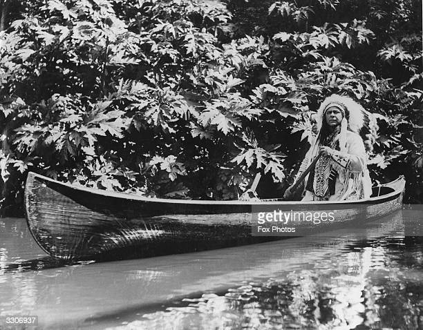 Chief OsKeNonTon paddles his canoe on the lake in Regent's Park He is in London from Canada to play the leading part in a stage production of...
