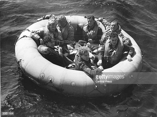 RAF crew members in a round lifeboat waiting for rescue during an exercise to test new exposure suits