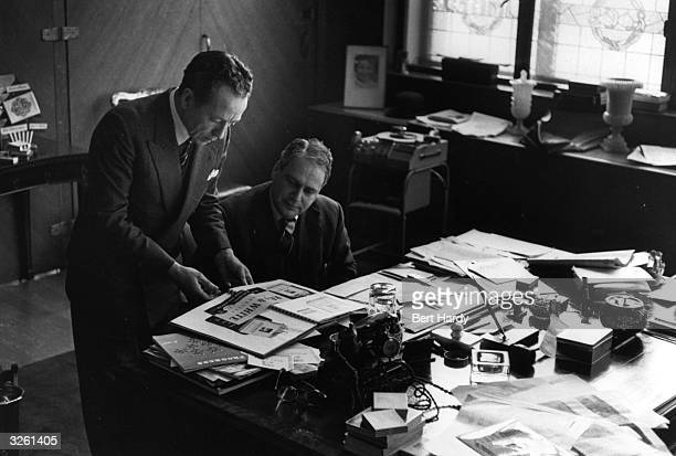 Advertising directors Mr Coppin and Godfrey Phillips develop ideas for a campaign to market 'Red White' brand cigarettes Original Publication Picture...