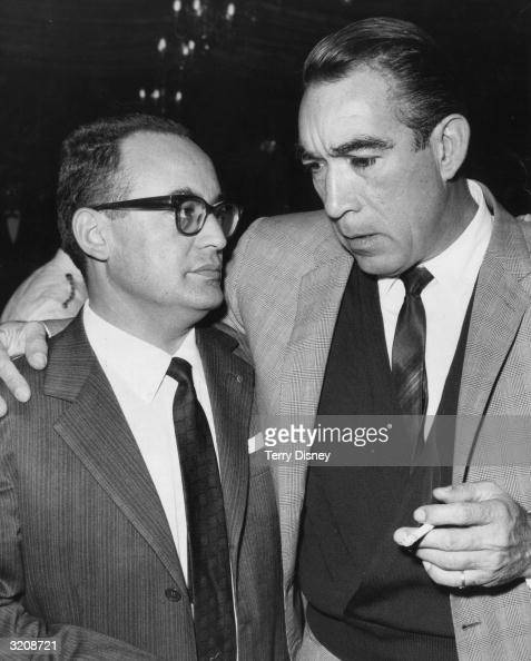 Italian film producer Dino de Laurentiis deep in conversation with actor Anthony Quinn at the premiere of 'Barabbas' at the New Odeon in London's...