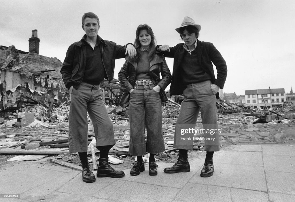 Teenagers wearing the latest trend cropped trousers known as 'parallels' in the ruins of Smithfield Market in Belfast Northern Ireland