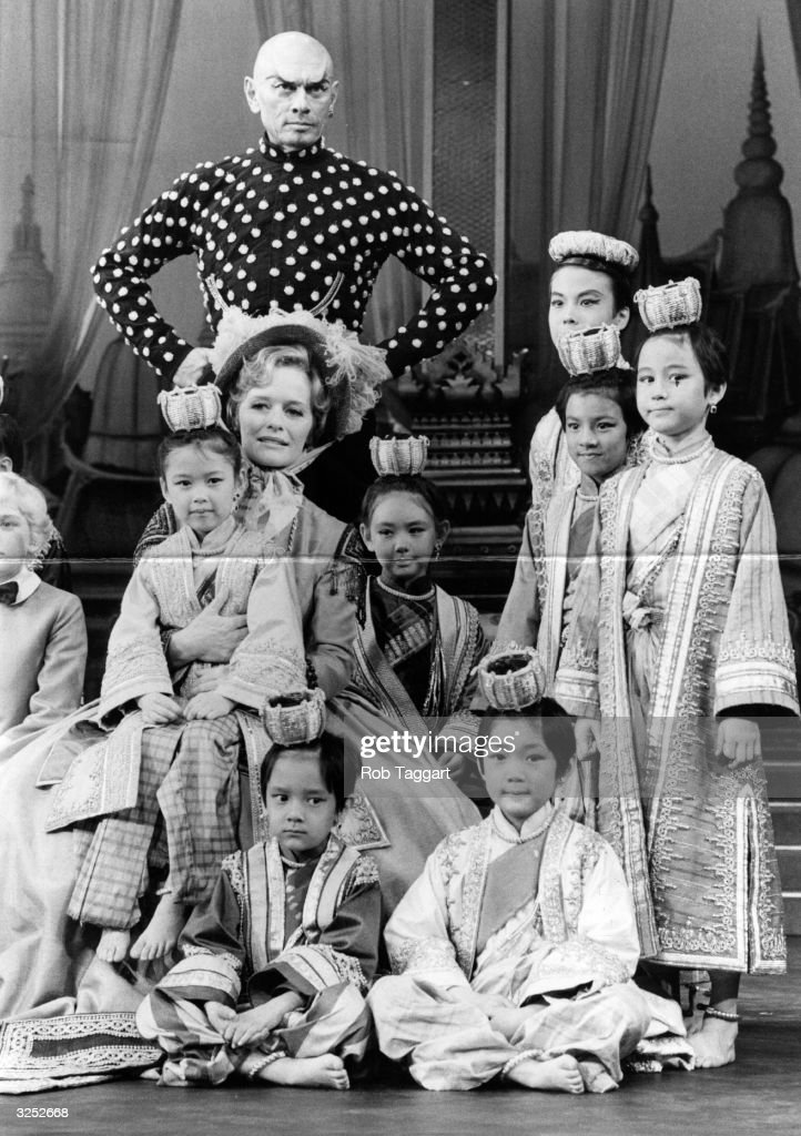 Yul Brynner, Virginia McKenna and some of the cast of the London stage production of the musical 'The King and I'.