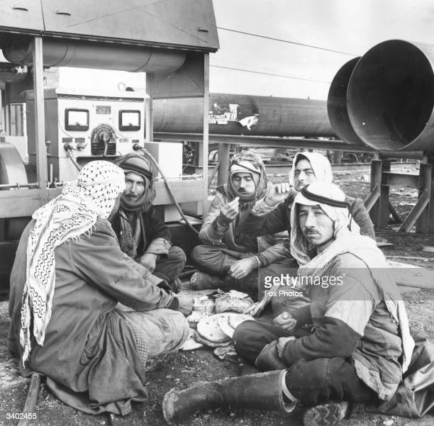 A group of Bedouin Arab men who are working on the laying of a 560 mile long pipeline from Kirkuk in north Iraq to Bania on the Syrian coast for the...