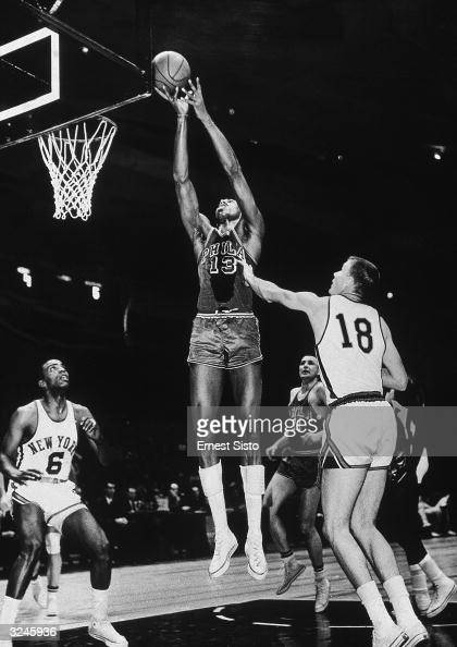 Philadelphia Warriors Wilt Chamberlain leaps to score in the first half of a game against the New York Knicks