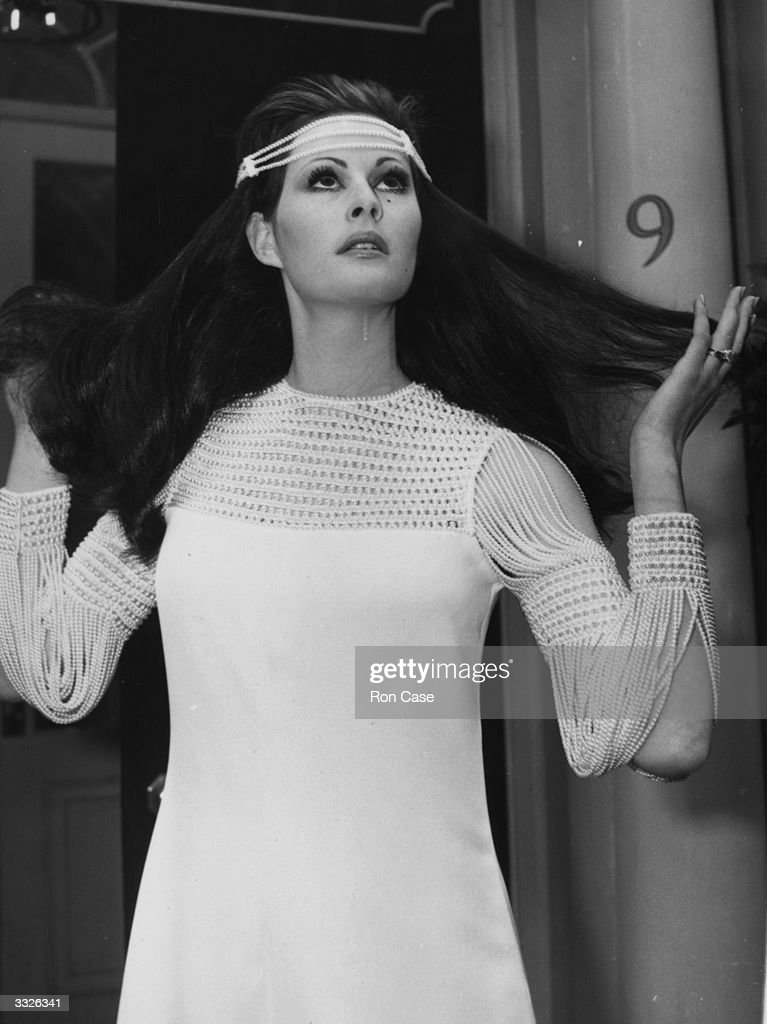 'Isadora Duncan', a white crepe evening dress with pearl sleeves and matching 'scarf-hat' worn by Shula Tavet from the Spring Collection at Christian Dior London.