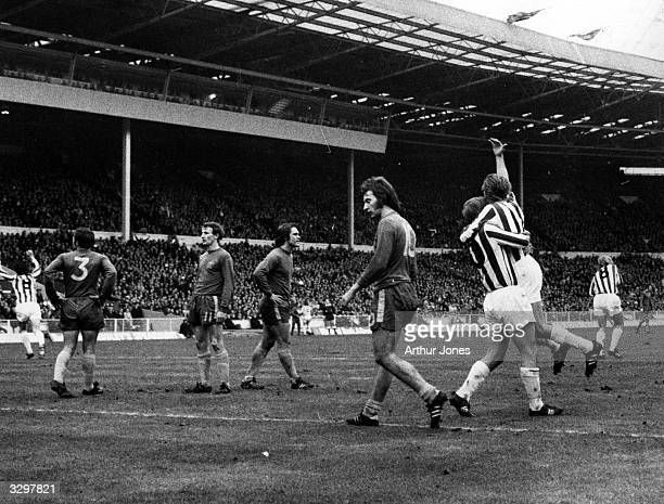 Dobing hugs George Eastham after Eastham scores the winning goal for Stoke City in the League Cup Final match against Chelsea at Wembley