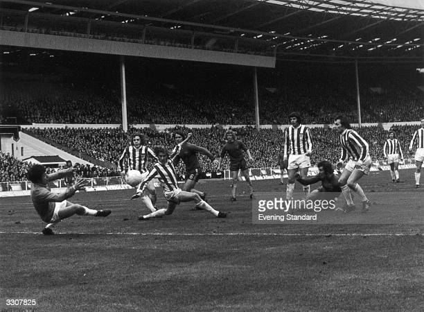 Stoke City goalkeeper Gordon Banks attempts to stop Chelsea's Peter Osgood scoring during the League Cup Final at Wembley which Stoke won 21