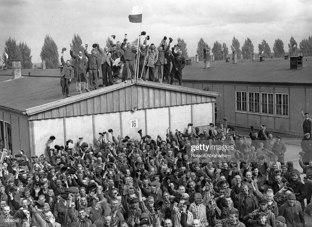Prisoners at Dachau, the infamous concentration camp, celebrate their liberation following the arrival of the men of the 42nd Rainbow Division of the US 7th Army.
