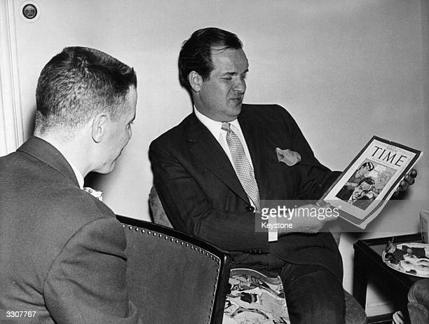 American cartoonist Al Capp 'the father of comic strips' admires himself on the cover of Time magazine at a press conference in Stuttggart