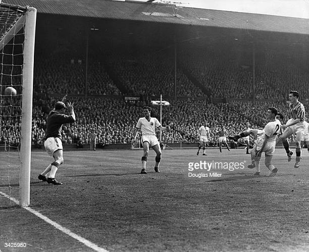 Peter McParland of Aston Villa scores his team's second and winning goal in the 1957 FA Cup final against Manchester United at Wembley Villa won 21