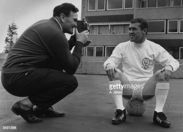Don Revie the manager of Leeds United FC filming Bobby Collins the team captain