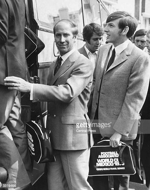 British footballer Bobby Charlton with Martin Peters and Geoff Hurst boarding a bus taking the England squad to London Airport where they fly out to...