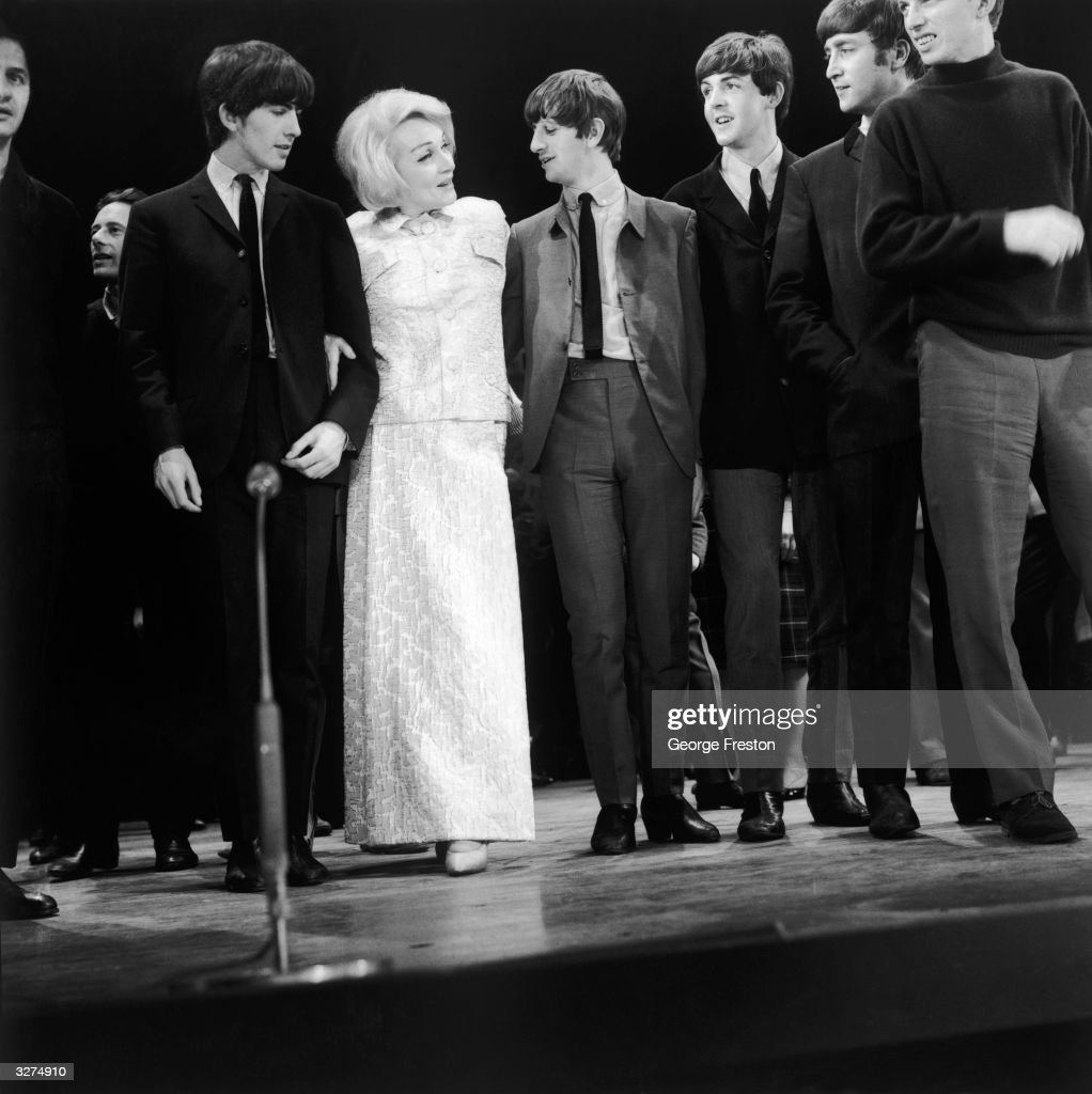 German born American actress Marlene Dietrich (1901 - 1992) with British pop group The Beatles, from left to right: <a gi-track='captionPersonalityLinkClicked' href=/galleries/search?phrase=George+Harrison&family=editorial&specificpeople=90945 ng-click='$event.stopPropagation()'>George Harrison</a> (1943 - 2001), Ringo Starr, <a gi-track='captionPersonalityLinkClicked' href=/galleries/search?phrase=Paul+McCartney&family=editorial&specificpeople=92298 ng-click='$event.stopPropagation()'>Paul McCartney</a> and John Lennon (1940 - 1980), during rehearsals for the Royal Variety Command Performance at the Prince of Wales Theatre in London.
