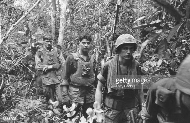 US marines on patrol in a jungle during the Vietnam war