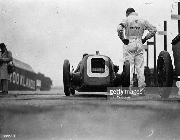 B C Special stops for a pit stop during a 500 mile race at Brooklands Weybridge Surrey