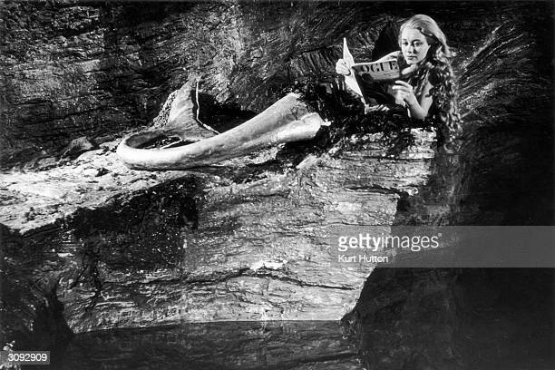 Actress Glynis Johns as Miranda a blonde mermaid living in a Cornish cave in a scene from the film 'Miranda' Original Publication Picture Post 4457 A...