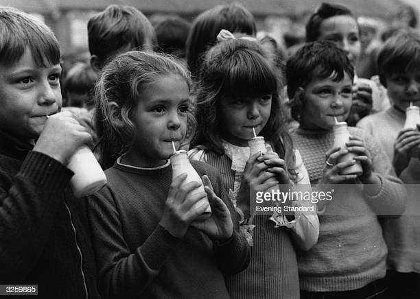Pupils at Woodhill Primary School Woolwich south London drink milk