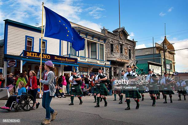 4th of July parade featuring a bagpipe marching band entertains vacationers in Skagway, Alaska