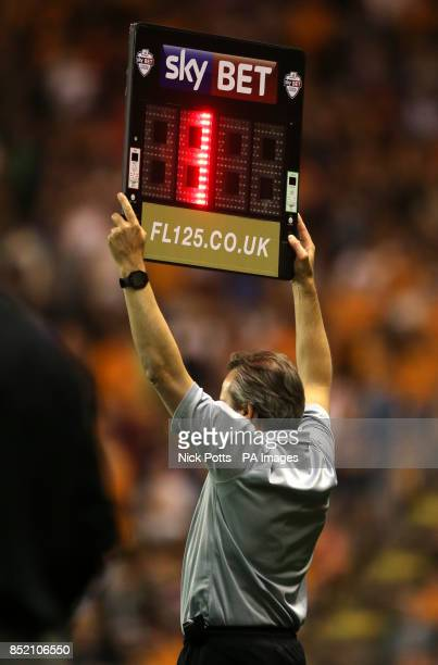 4th official shows the Skybet Football League substitutes time board during the Johnstones Paint Trophy match at Molineux Stadium Wolverhampton