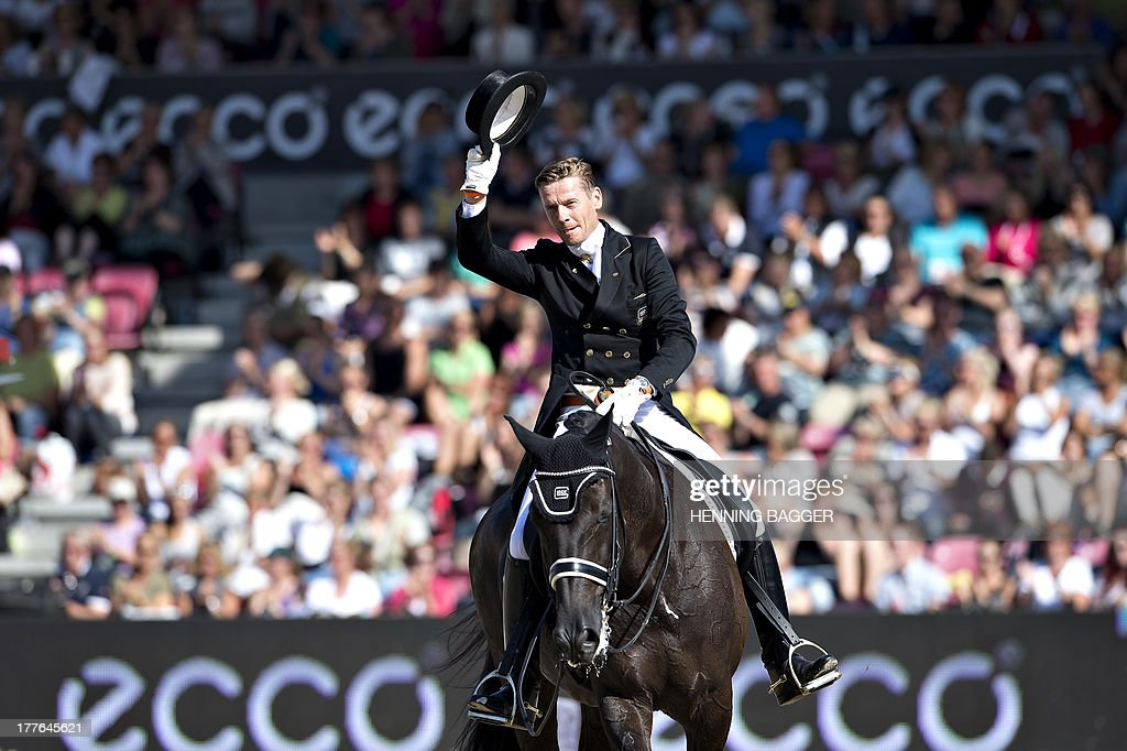 4th placed Dutch rider Edward Gal on his horse Glock's Undercover greets the audience during the FEI Dressage European Championship Finals in Herning, Denmark, on August 25, 2013. British rider Charlotte Dujardin won the event followed by 2nd placed German rider Helen and 3rd placed Dutch rider Adelinde Cornelissen. AFP PHOTO / SCANPIX DENMARK / HENNING BAGGER / DENMARK OUT