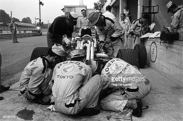 Mechanics working on the new Honda V12 car during the Italian Grand Prix at Monza