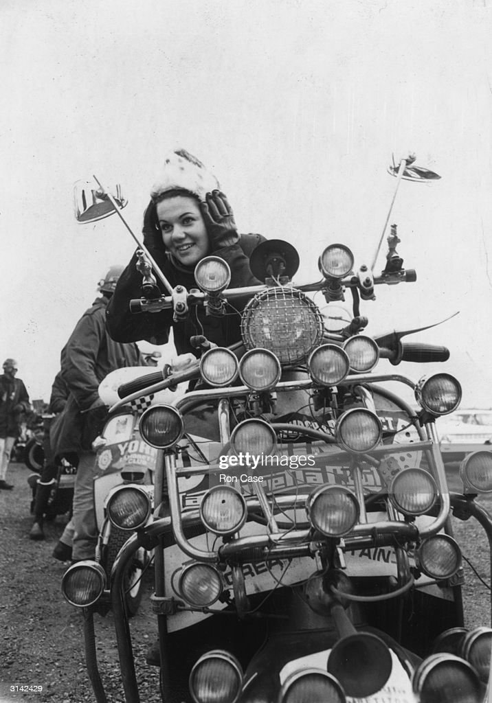 Nineteen year old Jill Roberts of Bournemouth adjusting her helmet before the start of the scooter rally organised by the Lambretta Club of Great Britain at Southend.