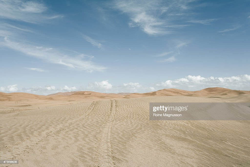 4wd motorcycle track in the desert : Stock Photo