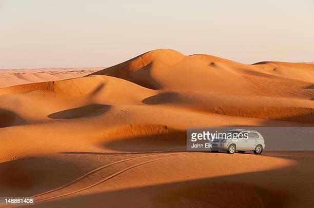 4wd vehicle on dune.