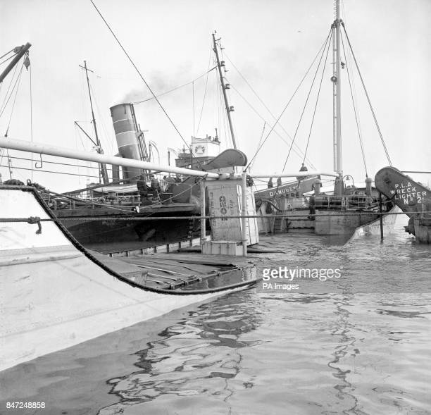 500ton Dutch cargo ship 'Alletta' is flanked by two Port of London Authority wreck lighters which will raise her after a morning collision on the...