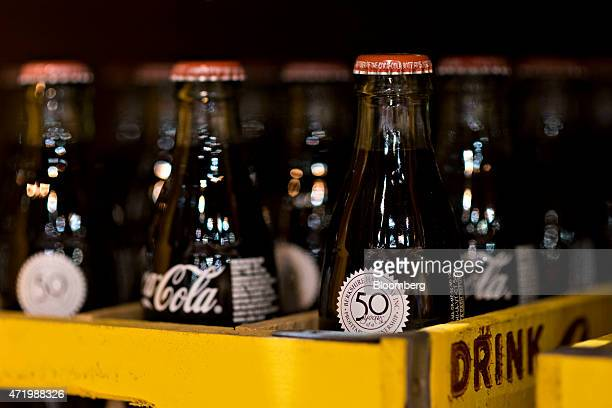 A 50th Anniversary logo appears on a special edition package of CocaCola during the Berkshire Hathaway Inc annual shareholders meeting in Omaha...