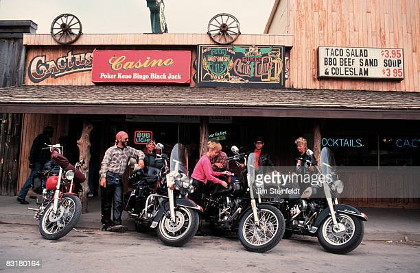 50th Anniversary of the World Famous Sturgis Motorcycle Rally Bikers standing in front of the Cactus Lounge in Sturgis South Dakota on August 6 1990