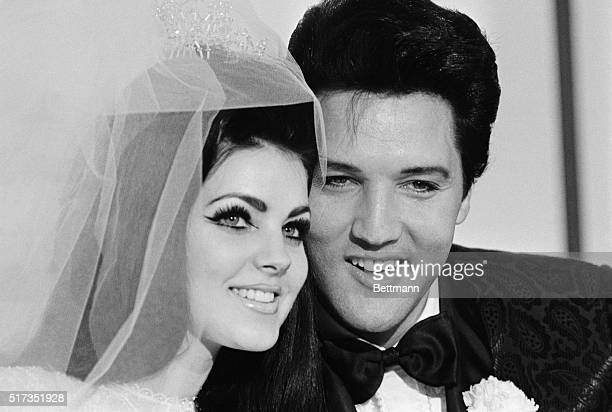 5/1/1967Las Vegas NV Singer Elvis Presley and his bride Priscilla Ann Beaulieu pose for photograph following their wedding at the Aladdin Hotel...